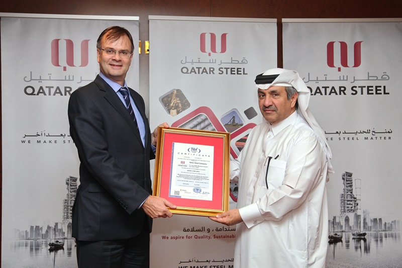 Administration division manager Mohamed Saleh al-Mahdi receives the ISO certification on behalf of Qatar Steel.